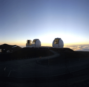 Keck domes. View of the summit at dusk, with the telescope doors open to equalise temperature inside and outside of the domes.